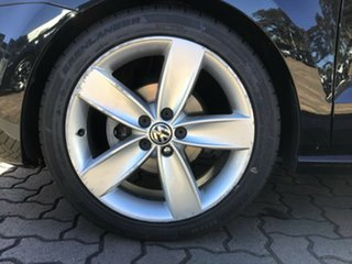 2010 Volkswagen Polo 6R 77TSI DSG Comfortline Black 7 Speed Sports Automatic Dual Clutch Hatchback