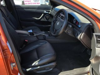 2007 Holden Commodore VE V Orange 4 Speed Automatic Sedan.