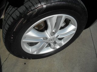 2013 Nissan Dualis J10W Series 3 MY12 ST Hatch 2WD Red 6 Speed Manual Hatchback
