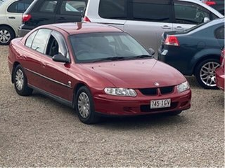 2001 Holden Commodore VX II Executive Red 4 Speed Automatic Sedan.