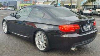 2010 BMW 3 Series E92 MY10 320d Steptronic Black 6 Speed Sports Automatic Coupe.