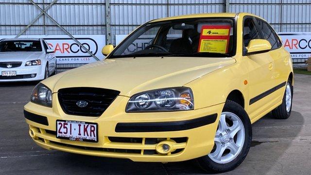 Used Hyundai Elantra XD MY04 Elite Rocklea, 2004 Hyundai Elantra XD MY04 Elite Yellow 5 Speed Manual Hatchback