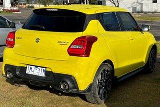 2018 Suzuki Swift Yellow Sedan.