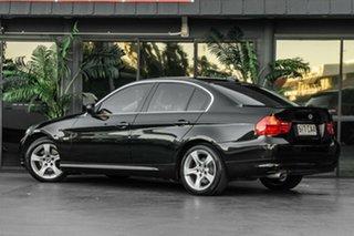 2010 BMW 3 Series E90 MY10.5 320d Steptronic Lifestyle Black 6 Speed Sports Automatic Sedan.