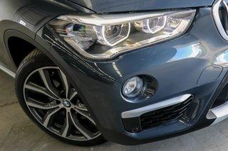 2015 BMW X1 F48 xDrive25i Steptronic AWD Blue 8 Speed Sports Automatic Wagon.