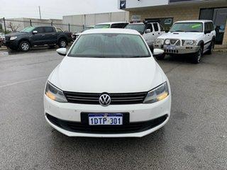 2011 Volkswagen Jetta 1KM MY10 118 TSI White 7 Speed Auto Direct Shift Sedan.