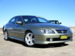 2004 Holden Calais VY II Gold 4 Speed Automatic Sedan.