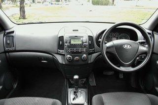 2010 Hyundai i30 FD MY10 SX cw Wagon Red 4 Speed Automatic Wagon.