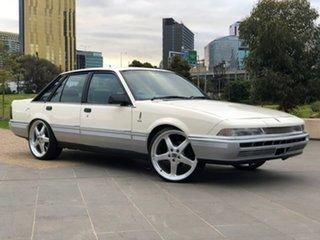 1987 Holden Calais VL Turbo White 4 Speed Automatic Sedan.