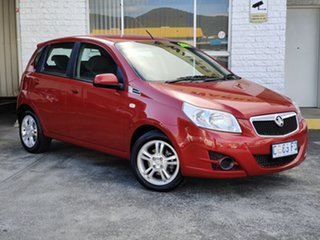 2011 Holden Barina TK MY11 Flame Red 4 Speed Automatic Hatchback.