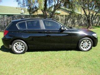 2014 BMW 1 Series F20 MY0314 116i Steptronic Black 8 Speed Sports Automatic Hatchback.