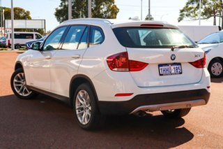 2015 BMW X1 E84 MY0714 sDrive18d White 8 Speed Sports Automatic Wagon.
