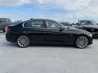 2015 BMW 3 Series F30 LCI 318i Luxury Line Black 8 Speed Sports Automatic Sedan.