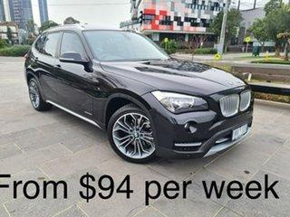 2014 BMW X1 E84 MY0314 sDrive20i Black 8 Speed Sports Automatic Wagon.