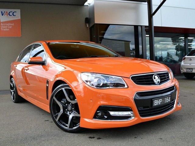 Used Holden Commodore VF MY14 SS V Fawkner, 2014 Holden Commodore VF MY14 SS V Orange 6 Speed Sports Automatic Sedan