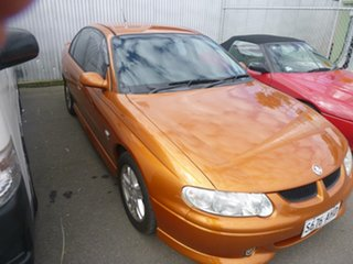 2001 Holden Commodore VX II S Orange 4 Speed Automatic Sedan.