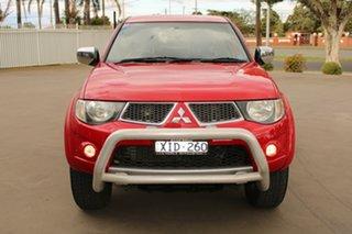 2009 Mitsubishi Triton MN MY10 GLX Red 4 Speed Automatic Double Cab Utility.