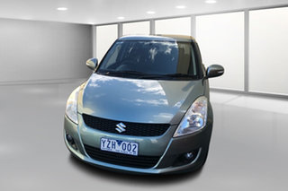 2011 Suzuki Swift FZ GLX Green 4 Speed Automatic Hatchback.