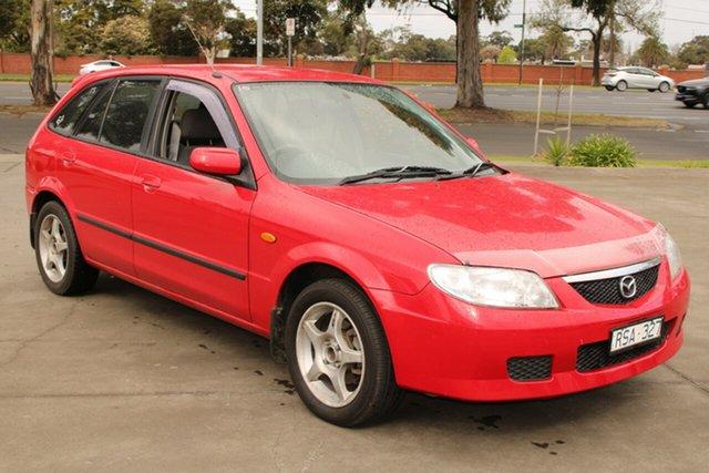 Used Mazda 323 Astina West Footscray, 2002 Mazda 323 Astina Red 5 Speed Manual Hatchback