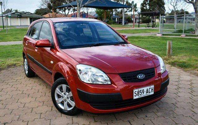 Used Kia Rio JB MY09 LX Ingle Farm, 2009 Kia Rio JB MY09 LX Orange 5 Speed Manual Hatchback