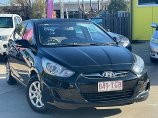 2013 Hyundai Accent RB Active Black 5 Speed Manual Hatchback.