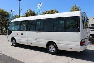 2012 Toyota Coaster Deluxe White Automatic Midi Coach