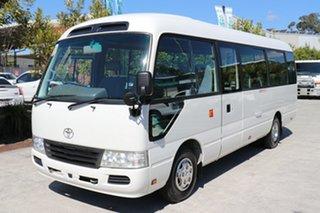 2012 Toyota Coaster Deluxe White Automatic Midi Coach.