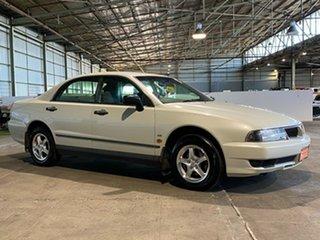 1999 Mitsubishi Magna TH Executive White 4 Speed Automatic Sedan.
