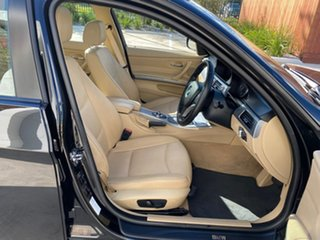 2009 BMW 3 Series E90 MY09 320i Steptronic Executive Black 6 Speed Sports Automatic Sedan.