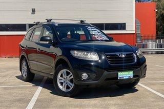 2010 Hyundai Santa Fe CM MY10 Elite CRDi (4x4) Black 6 Speed Automatic Wagon.