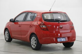 2012 Hyundai i20 PB MY12 Active Electric Red 5 Speed Manual Hatchback.