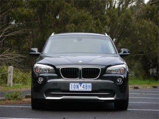 2010 BMW X1 E84 sDrive20d Steptronic Black 6 Speed Sports Automatic Wagon.