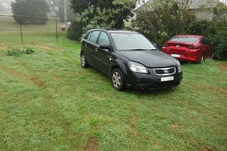 2010 Kia Rio JB MY10 S Black 4 Speed Automatic Hatchback.