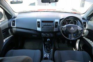 2009 Mitsubishi Outlander ZH MY10 LS Red 5 Speed Manual Wagon.