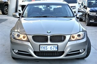 2011 BMW 3 Series E91 MY1011 320d Touring Steptronic Lifestyle Gold 6 Speed Sports Automatic Wagon.