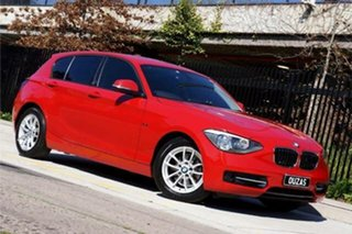 2015 BMW 1 Series F20 MY0714 116i Steptronic Red 8 Speed Sports Automatic Hatchback.