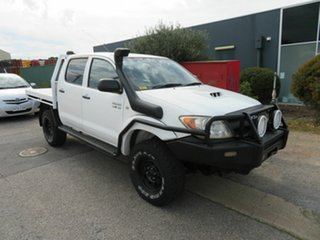 2005 Toyota Hilux KUN26R SR (4x4) White 5 Speed Manual Dual Cab Chassis.