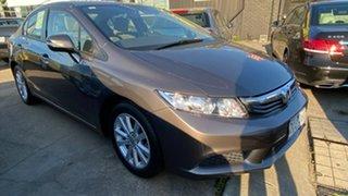 2012 Honda Civic 9th Gen VTi-L Brown 5 Speed Sports Automatic Sedan.