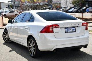 2014 Volvo S60 F Series MY15 T4 PwrShift Luxury White 6 Speed Sports Automatic Dual Clutch Sedan.