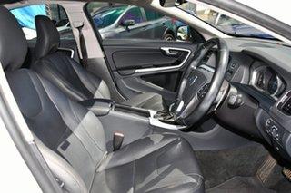 2014 Volvo S60 F Series MY15 T4 PwrShift Luxury White 6 Speed Sports Automatic Dual Clutch Sedan