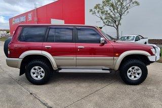 1998 Nissan Patrol GU TI Red 4 Speed Automatic Wagon.