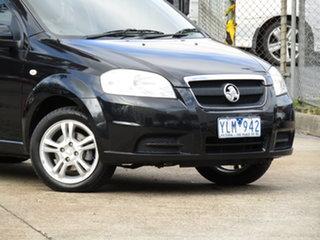 2011 Holden Barina TK MY11 8 Ball Black 4 Speed Automatic Sedan