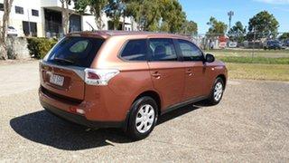 2012 Mitsubishi Outlander Orange Wagon.