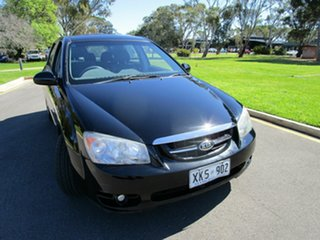 2006 Kia Cerato LD Black 4 Speed Automatic Hatchback.
