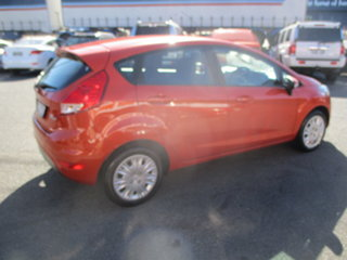 2014 Ford Fiesta WZ Ambiente Orange 5 Speed Manual Hatchback.