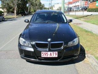 2008 BMW 3 Series E90 MY08 320i Steptronic Executive Black 6 Speed Sports Automatic Sedan.