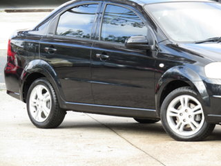 2011 Holden Barina TK MY11 8 Ball Black 4 Speed Automatic Sedan.