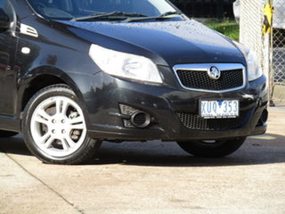 2010 Holden Barina TK MY10 Abyss Black 5 Speed Manual Hatchback.