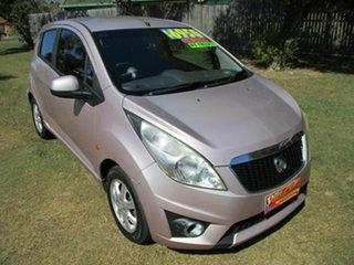 2010 Holden Barina Spark MJ MY11 CD Pink 5 Speed Manual Hatchback