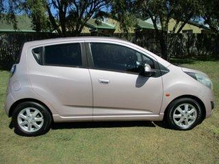 2010 Holden Barina Spark MJ MY11 CD Pink 5 Speed Manual Hatchback.